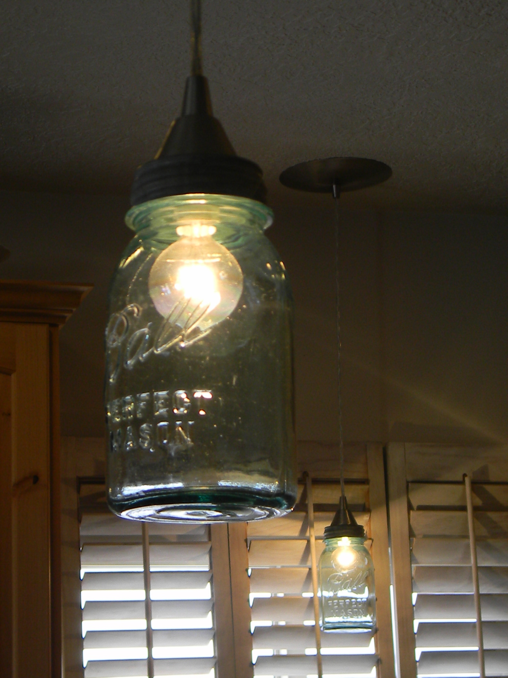 Lamps on pinterest rustic lamps cedar wood and floor lamps for Hanging lights made from mason jars