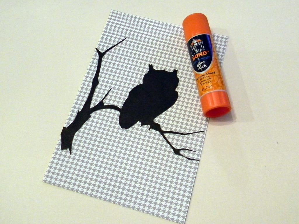 Attach Halloween Silhouettes to patterned paper