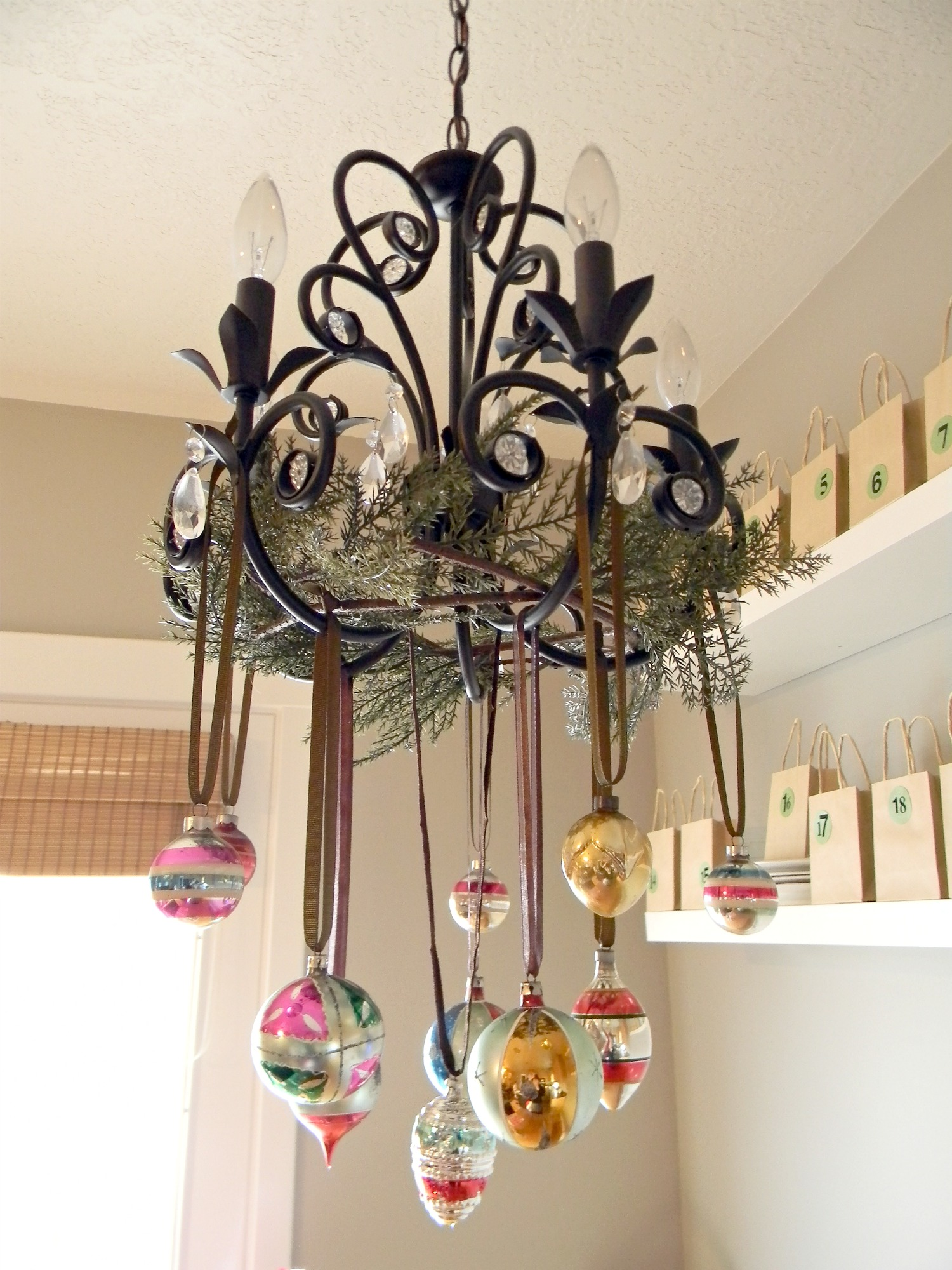 Natural outdoorsy woodsy christmas decor organize and for Hanging ornaments from chandelier
