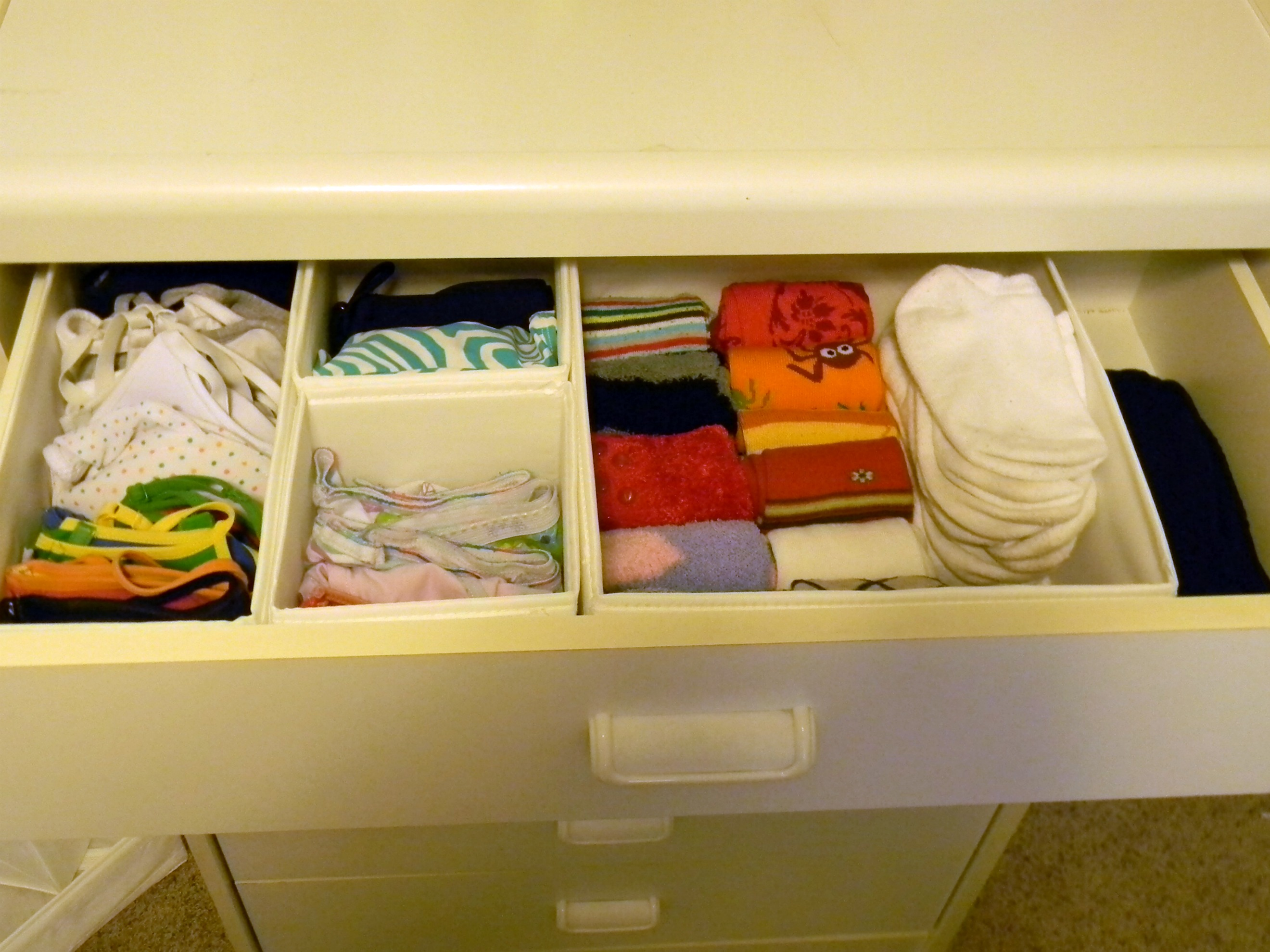 Using Storage Boxes To Organize The Dresser Drawers