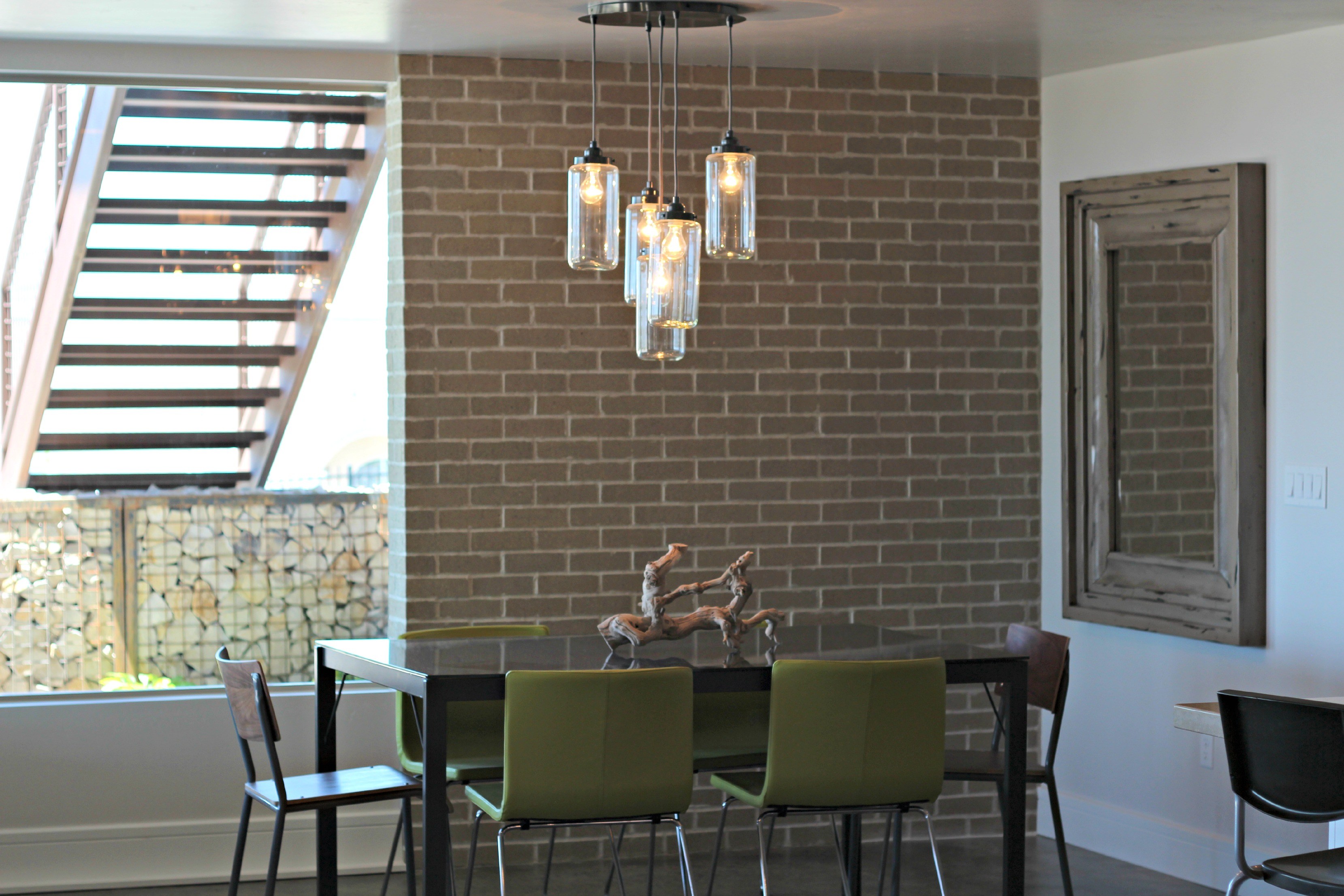 More paint colors from the uv parade of homes my favorite home - I Love The Brick Wall In The Dining Area And The Gabion Wall Just Outside The Window The Light Fixture Is One Of My Favorite Dining Room Lights
