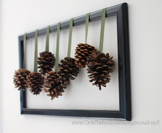 pinecones hanging from frame