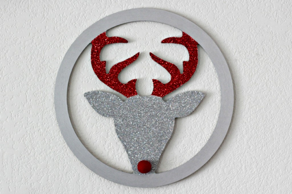 Red and Black Mantel hanging deer