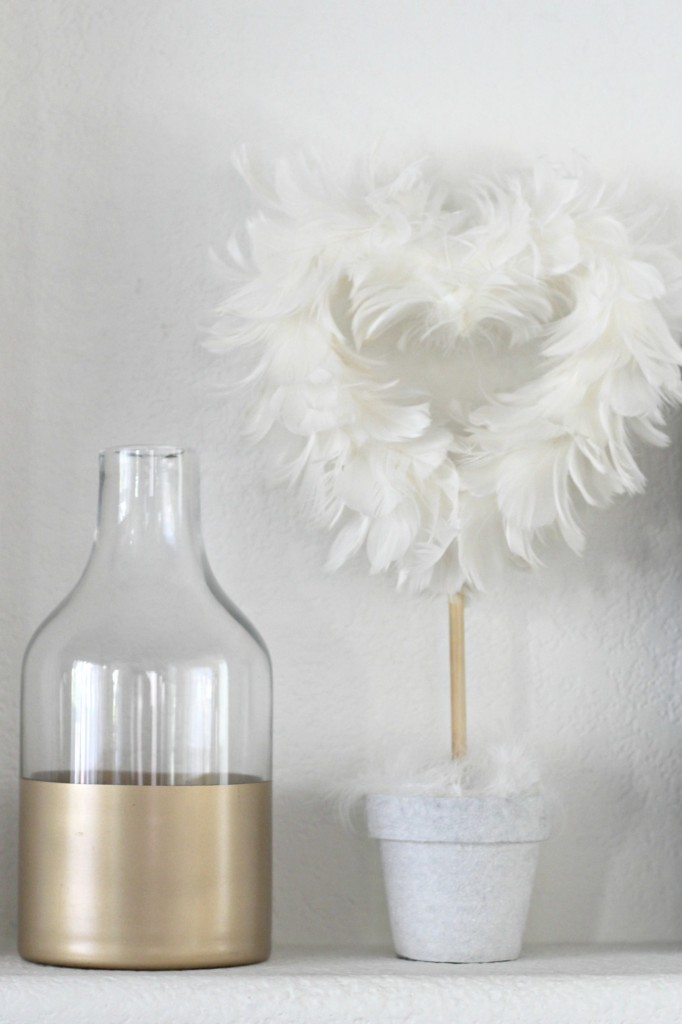 Gold bottle and feather heart topiary