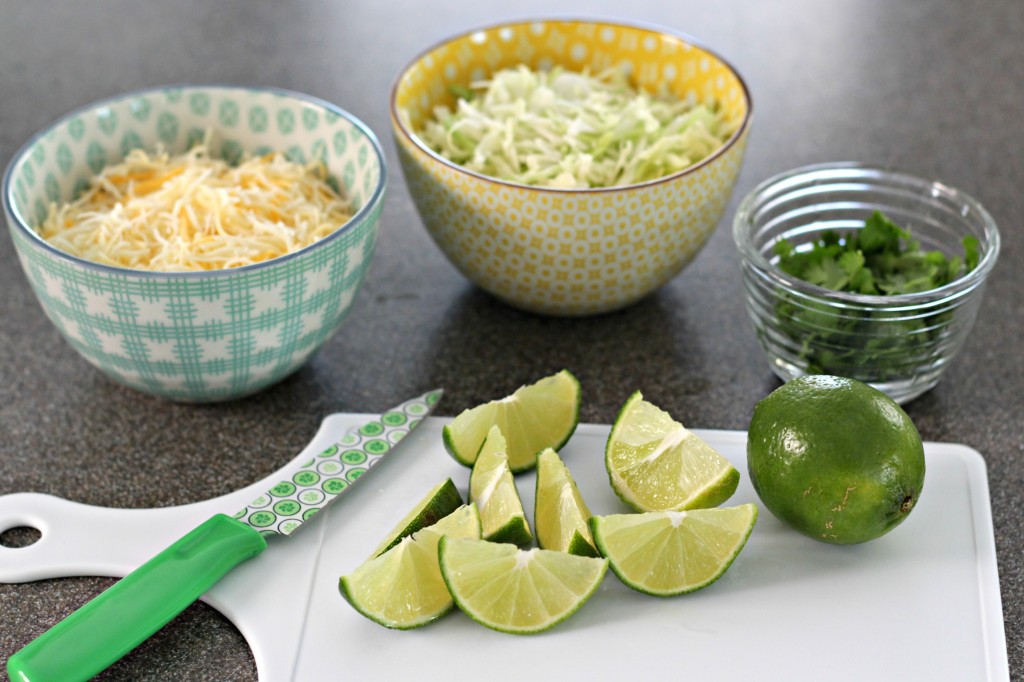 3-ingredient-pork-tacos-limes-cheese-cabbage-cilantro