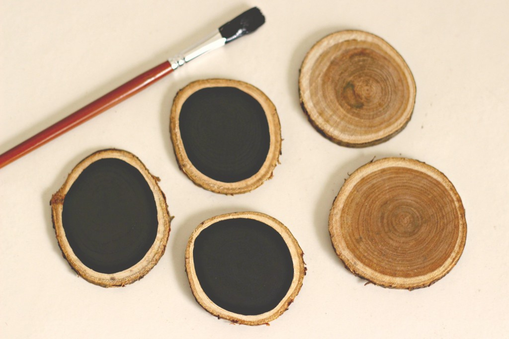 wood-slice-ornament-being-painted
