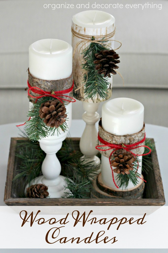 wood-wrapped-candles-with-pine-accents-for-christmas-decor