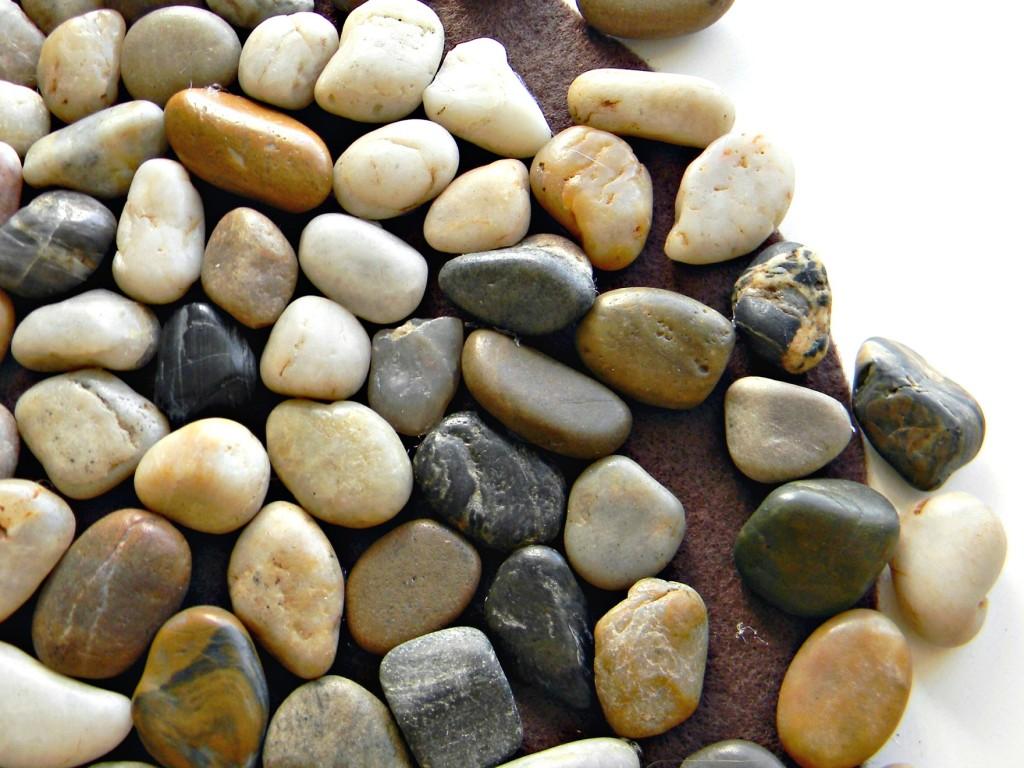 Rock Trivet gluing rocks on felt bottom