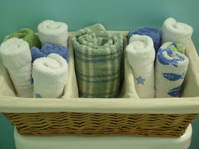 Organizing with baskets bathroom towels
