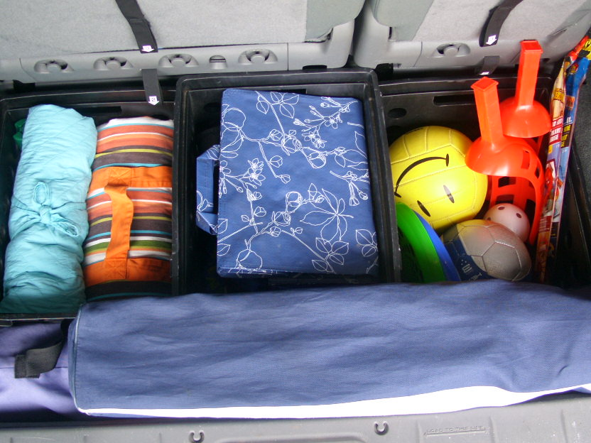 organizing with baskets car
