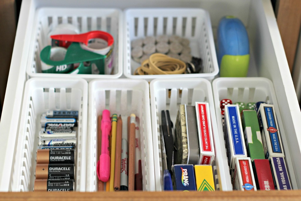 organizing with baskets junk drawer