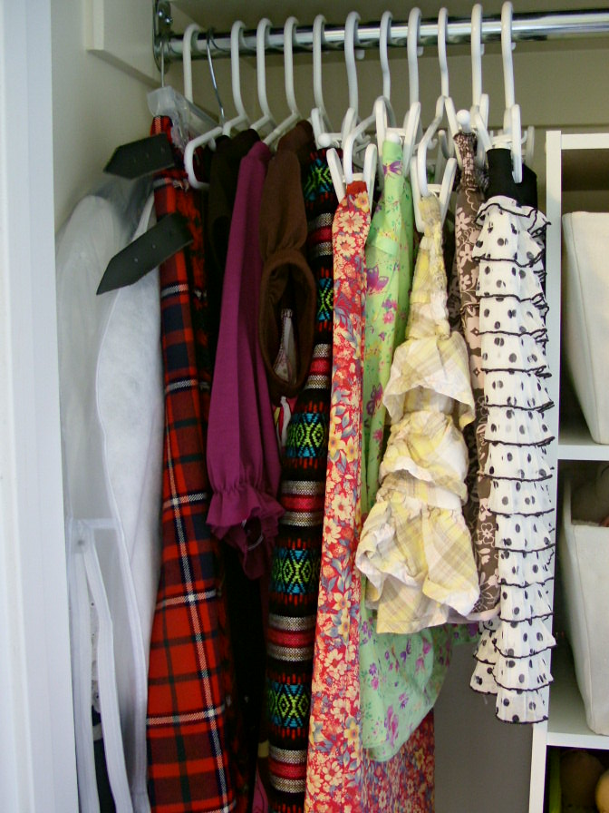 decluttering in august kids hanging clothes