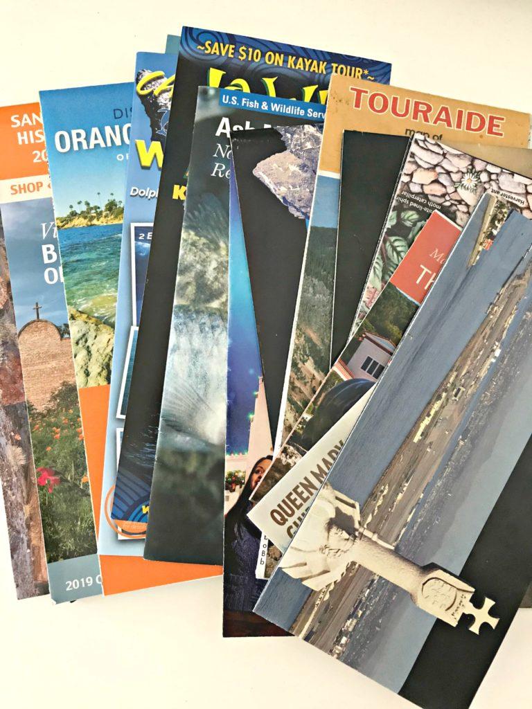 June decluttering travel brochures